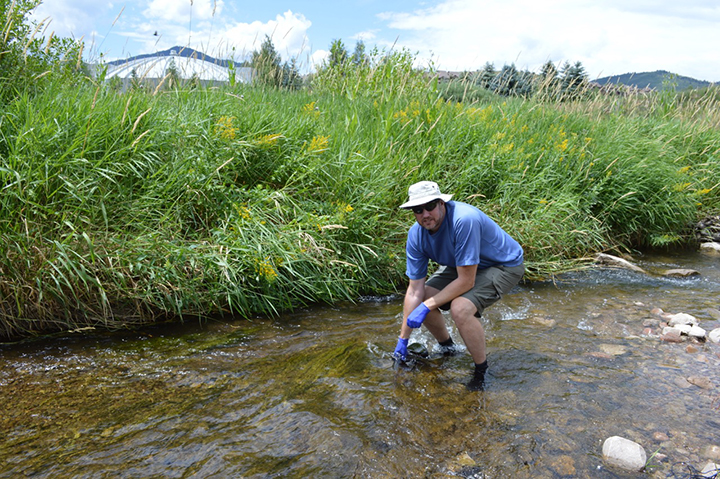 water sampling in East Canyon Creek, UT