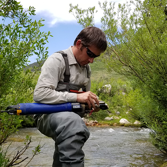 Patrick Strong maintaining LRO sensor in the Logan River