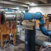 Flowmeter performance testing downstream of bends