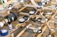 Residential flowmeter testing