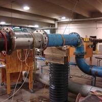 Flowmeter performance testing downstream of bends