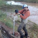 Measuring the ground water table depth within a BDA section of the San Rafael River during a high-flow event.