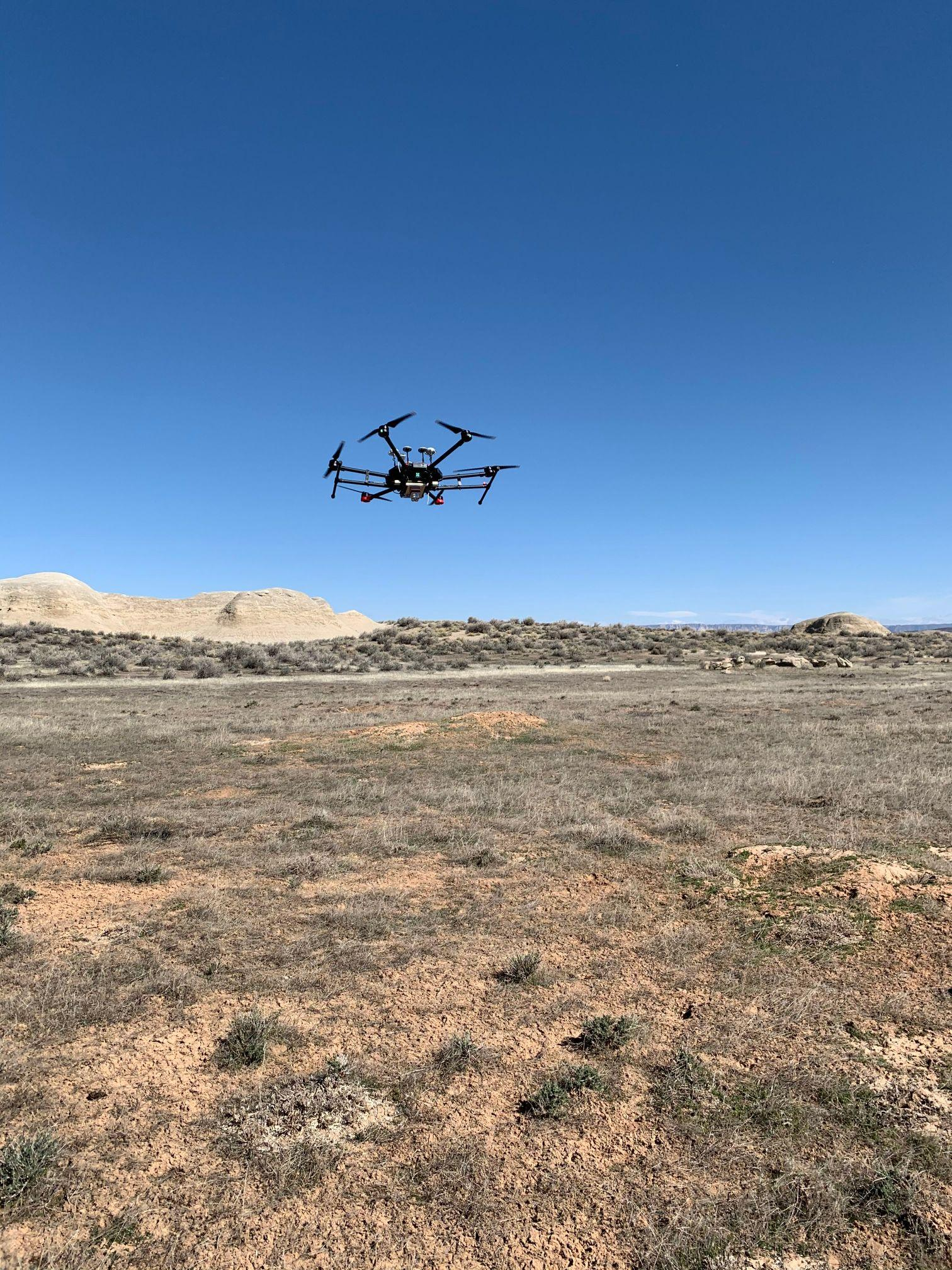 AggieAir's UAV Matrice M 600 Pro in flight above the prairie dog town.